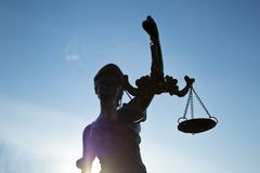 Statue of justice. Sky background stock photos