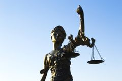 Statue of justice. Sky background royalty free stock image