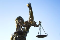Statue of justice. Sky background stock photo