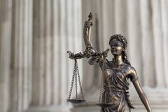 The statue of justice Themis/Justitia, the blindfolded goddess. The statue of justice Themis or Justitia, the blindfolded goddess of justice against an ionic royalty free stock image