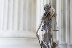 The statue of justice Themis/Justitia, the blindfolded goddess. The statue of justice Themis or Justitia, the blindfolded goddess of justice against an ionic stock photography