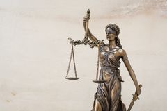 The statue of justice Themis/Justitia, the blindfolded goddess. The statue of justice Themis or Justitia, the blindfolded goddess of justice against marble wall stock photo