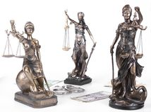 Statue of Justice Themis with money euros and dollars. Bribe and crime concept. royalty free stock images