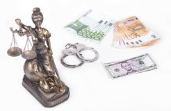Statue of Justice Themis with money euros and dollars. Bribe and crime concept. Stock Photography