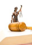 Statue of justice on a white background. vertical photo. Stock Photography