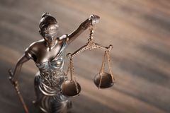 Statue of justice on wood background. Justice lady lawyer legal litigation abstract royalty free stock image