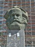Statue of Karl-Marx. The statue is placed in the center between the buildings in Chemnitz. Nice big bust. Between 1953 to 1990 it was called Karl-Marx-Stadt by royalty free stock image