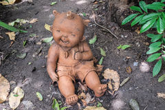 Statue of kid. In the garden Stock Image