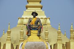 Statue of the King Chao Anouvong in front of the Pha That Luang stupa in Vientiane, Laos. Royalty Free Stock Photo