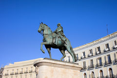 Statue of King Charles III in Madrid Stock Photos