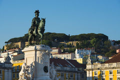 The Statue of the King Dom Jose in the Commerce Square Praca do Comercio with the Saint George Castle Castelo de Sao Jorge in Royalty Free Stock Photos