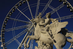 Statue of King of Fame riding Pegasus on the Place de la Concorde with ferris wheel at background, Paris, France Stock Image