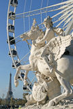 Statue of King of Fame riding Pegasus on the Place de la Concorde with ferris wheel and Eiffel tower at background, Paris, France Royalty Free Stock Photos