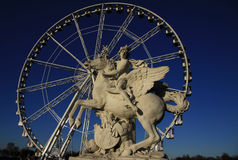 Statue of King of Fame riding Pegasus on the Place de la Concorde with ferris wheel, Paris, France Stock Photo