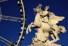 Statue of King of Fame riding Pegasus on the Place de la Concorde with ferris wheel, Paris, France Stock Images