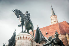 Statue of King Mathias in front of the church of Saint Michael Royalty Free Stock Photos