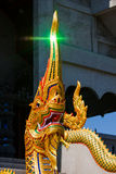 Statue king of nagas in front of buddhism temple Royalty Free Stock Images