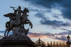 Statue of the King`s Fame Riding Pegasus. Paris, France - August 11, 2017. Statue of Renommee in the evening. Trumpeting Hermes and Pegasus at the entrance of royalty free stock photos