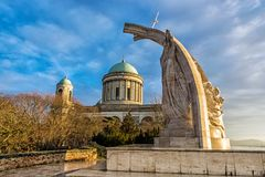 Statue of King Saint Stephen and basilica in Esztergom, Hungary. Statue of King Saint Stephen and monumental basilica in Esztergom, Hungary. Sunset scene. Travel stock photos