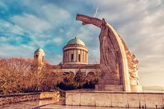 Statue of King Saint Stephen and basilica in Esztergom. Statue of King Saint Stephen and monumental basilica in Esztergom, Hungary. Sunset scene. Travel royalty free stock photos