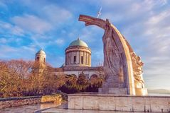 Statue of King Saint Stephen and basilica in Esztergom. Statue of King Saint Stephen and monumental basilica in Esztergom, Hungary. Sunset scene. Travel royalty free stock image