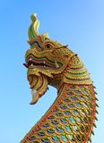 Statue king of Serpent in front of buddhism temple Royalty Free Stock Images