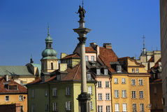 Statue of King Sigmundus. Column of King Sigmundus III in Warsaw and old town buildings behind Royalty Free Stock Photos