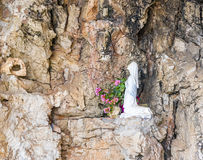 Statue of a kneeling virgin Stock Images