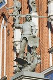 Statue of the knight defeating a dragon in front of the House of Blackheads in Riga, Latvia. Stock Photography