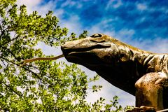 Statue of Komodo Dragon with forked tongue stock image