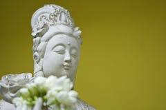 Statue of Kuan Yin image of buddha Chinese art. On yellow background Royalty Free Stock Photos