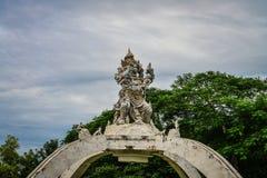 Statue of Kumbakarna Karebut. With nice blue sky at Pura Luhur Uluwatu Tample, Bali, Indonesia Royalty Free Stock Image