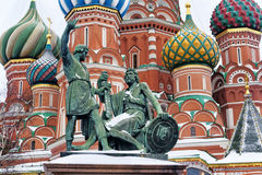 Statue of Kuzma Minin and Dmitry Pozharsky and St. Basil`s Cathe. Dral detailed and covered by snow on Red Square in Moscow, Russian Federation Stock Images