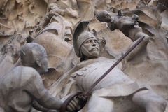 Statue at La Sagrada Familia. Detail of a carved scene depicting Harrod's slaughter of the innocents in the nativity facade of La Sagrada Familia Cathedral in Royalty Free Stock Photo