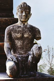 Statue of lacking arms. Statue of a young man who lost an arm. Old and decaying taken in  Thailand.n Royalty Free Stock Images