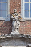 Statue Lady Justice on an ancient facade, Breda, Netherlands royalty free stock photo