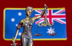 Australian Lady Justice. Statue of lady Justice and Australian flag on the red background Stock Images