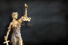 Statue of Lady Justice With Black Board Background. Statue of Lady Justice on Black Board Background royalty free stock photography