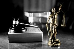 Statue of Lady Justice with black and white background. Lady Justice is an allegorical personification of the moral force in judicial systems. Her attributes are royalty free stock images
