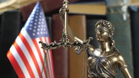 Statue of Lady Justice with Books and USA Flag