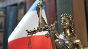 Statue of Lady Justice with Bookshelf with Books and France Flag Background. Statue of Lady Justice with Bookshelf with Books and United Kingdom Flag Background stock video