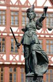 Statue of Lady Justice in Frankfurt. Statue of Lady Justice with a sleeping pigeon Royalty Free Stock Photo