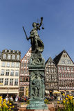 Statue of Lady Justice in Frankfurt, Germany. FRANKFURT, GERMANY- APR 8, 2015:Justitia Statue at the Romer square, one of the oldest and most historic sections stock photography