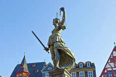 Statue of Lady Justice in front. Of the Romer in Frankfurt - Germany royalty free stock image