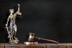 Statue of Lady Justice with Judges Hammer. On Black Board Background stock images