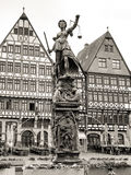 Statue of Lady Justice (Justitia) in Frankfurt, Germany. Old town square Romerberg with Justitia statue in Frankfurt, Germany. Black and white photography, sepia stock photography