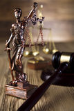 Statue of lady justice, Law concept. Gavel on books, ambient light vivid theme royalty free stock photography