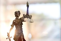 Statue of Lady Justice. With Sun Rising Background stock photo