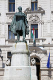 Statue of Lajos Kossuth and governmental building in Pecs, Hunga Royalty Free Stock Photos