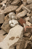 Statue laying in rubble Stock Photos